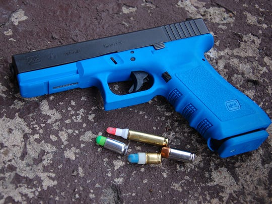 "This bright blue ""Simunition"" training handgun will be used to fire blanks during an active shooter training drill."