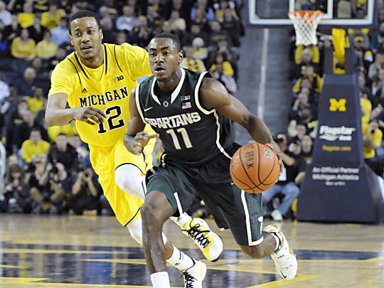 "MSU's Lourawls ""Tum Tum"" Nairn pushes the ball up court past Michigan's Muhammad-Ali Abdur-Rahkman on Feb. 17 in Ann Arbor. The Spartans are 4-0 since Nairn was inserted into the starting lineup."