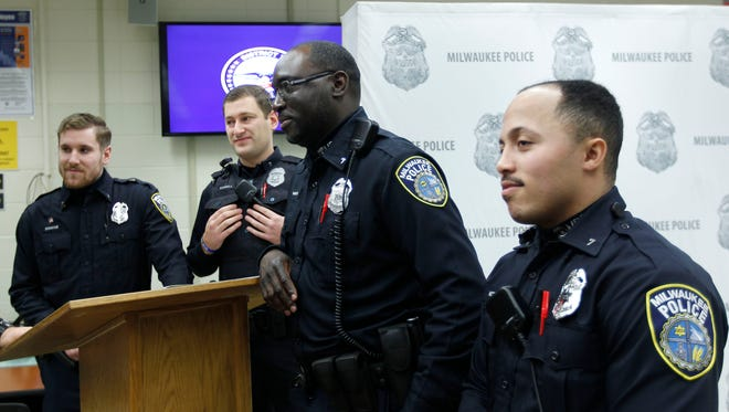 The Milwaukee police officers who were involved in the capture of homicide suspect Hakeem Tucker (not pictured) are Evan Domine (from left), Andrew Schnell, Omarlo Phillips and Richard Voden. Chief Edward Flynn (not pictured) and Mayor Tom Barrett (not pictured) praised the officers for avoiding use of deadly force in the tense arrest.