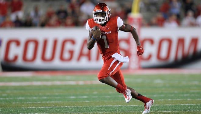 Houston quarterback Greg Ward Jr. runs on a keeper against SMU in the second half at TDECU Stadium.