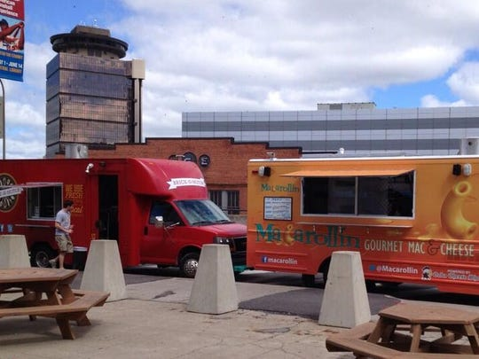 Two food trucks on Broad Street near the library.