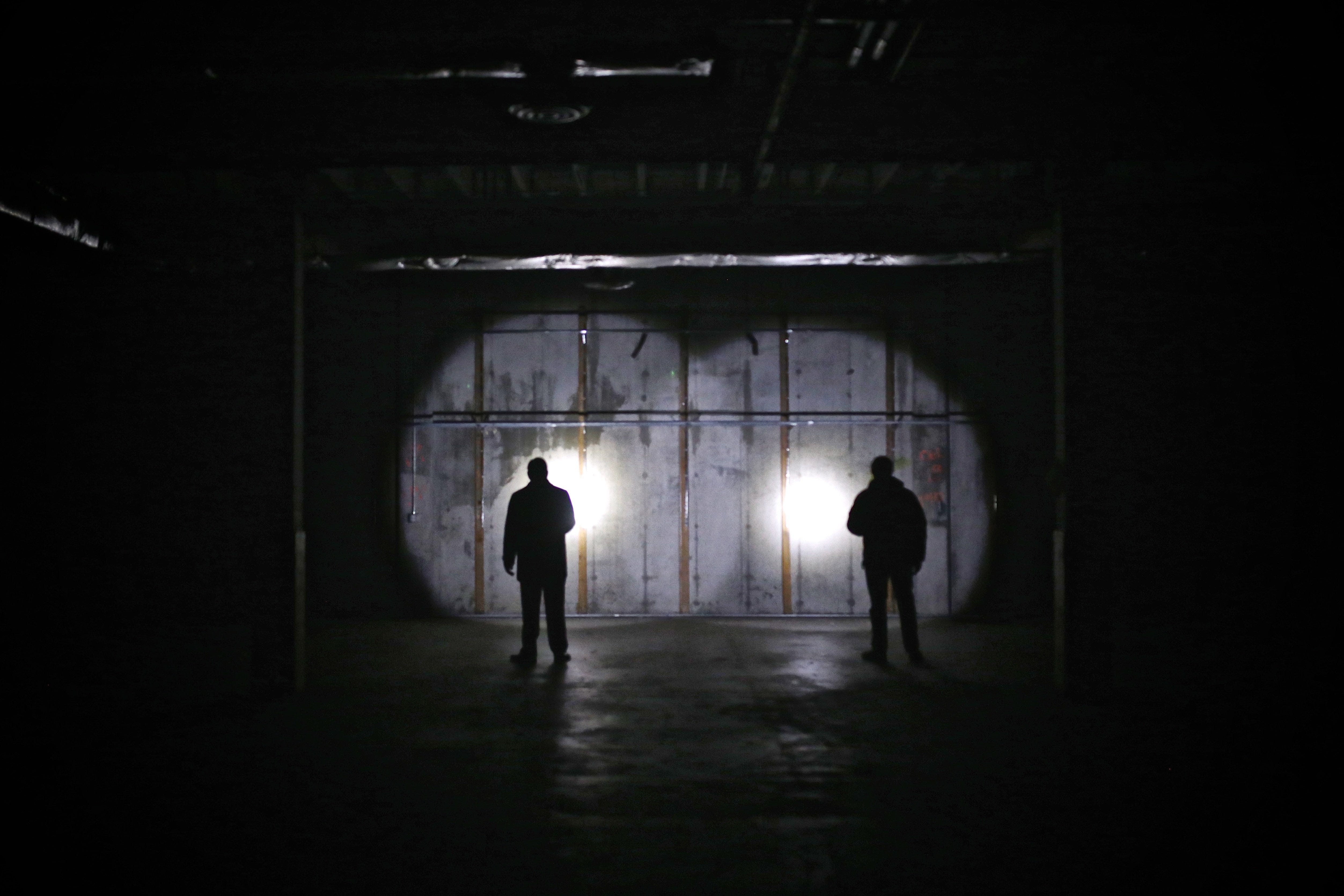 Security guards and media members explore one of the & Northland mall tunnels reveal their secrets
