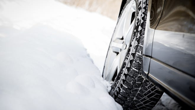 Pack an emergency kit and check on road conditions before traveling to snow country.