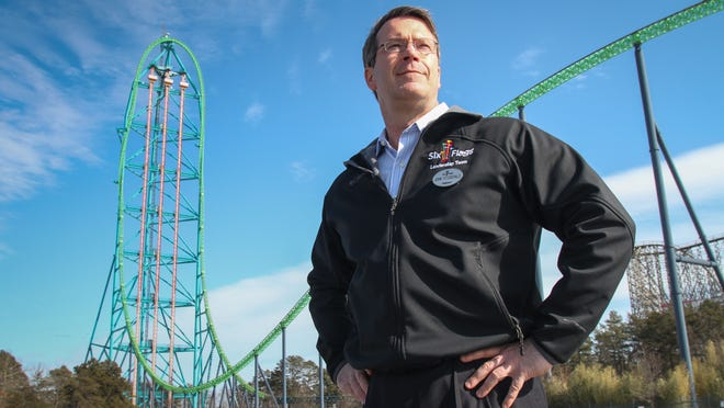 Six Flags Great Adventure's president John Fitzgerald stands in front of Kingda Ka, a coaster that climbs up to 456 feet high.