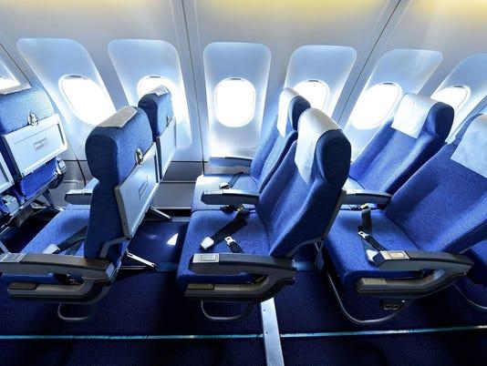 Blue airplane empty seats