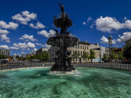 The Court Square Fountain and the Alabama State Capitol Building on Dexter Avenue in Montgomery on July 6, 2017. While more than a quarter-million people call Montgomery home, it has somehow managed to maintain a tight-knit feel.