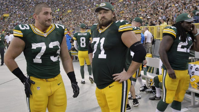 Green Bay Packers center JC Tretter (73) and guard Josh Sitton (71) are shown during the second quarter of their game against the Cleveland Browns Friday, August 12, 2016 at Lambeau Field in Green Bay, Wis.  MARK HOFFMAN/MHOFFMAN@JOURNALSENTINEL.COM