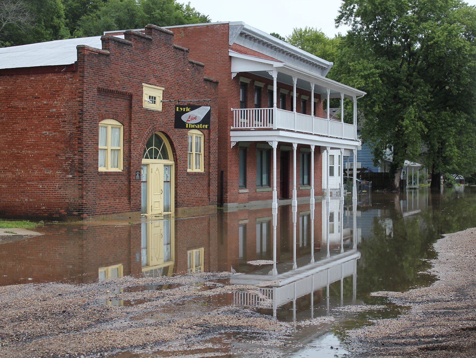 Floodwater surrounds the historic Lyric Live Theater in downtown Newburg, Mo.