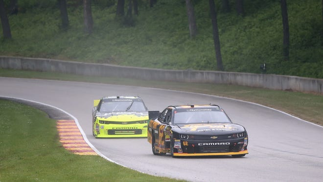 Brendan Gaughan leads Justin Marks during a 2014 NASCAR Xfinity Series race at Road America in Elkhart Lake, Wis.