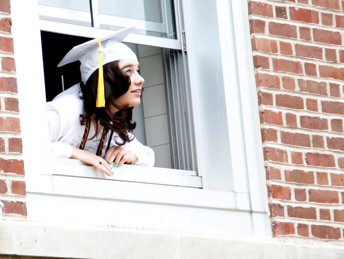 Kristine Moss looks for rain before The Ursuline School's 117th Commencement ceremony May 30, 2014.
