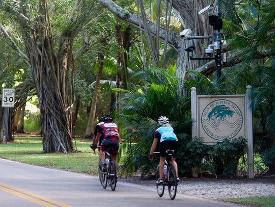 Bikers riding nearby the entrance to the town of Jupiter