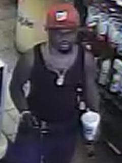 This surveillance camera image from the Five Points Liquor Store shows a man wanted by the Delaware State Police in connection with a July 6 robbery on Woodland Ferry Road.
