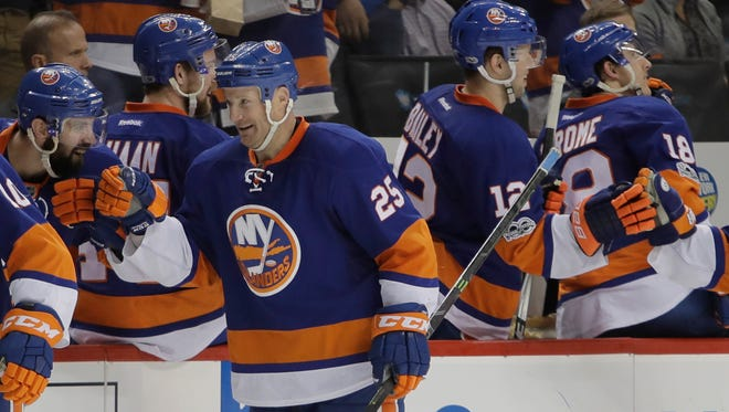 Islanders' Jason Chimera (25) celebrates with teammates after scoring a goal during the third period of a game against the Columbus Blue Jackets, Tuesday, Jan. 24, 2017, in New York. The Islanders won 4-2.