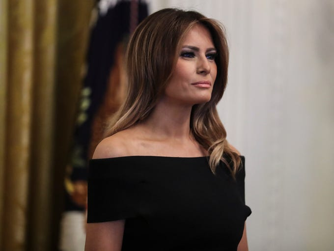 First lady Melania Trump looks on as President Donald