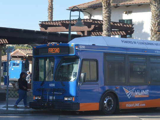 Users get on the V-Line, the daily Visalia-Fresno shuttle. Visalia transit receives federal funding for the bus service.