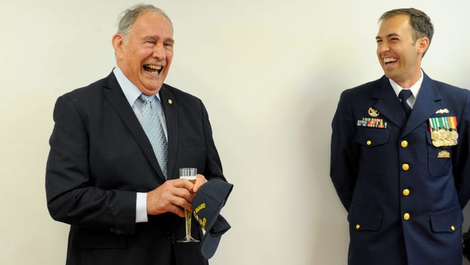 John Tyler, left, shares his stories about when he was hired to oversee the U.S. Coast Guard in Ventura County in 1973 and started the station at Channel Islands Harbor. To his right is Lt. Thomas Wieland, the station's outgoing commanding officer. On Friday, the Coast Guard dedicated the John Tyler Room in honor of his service as the station's first master chief.