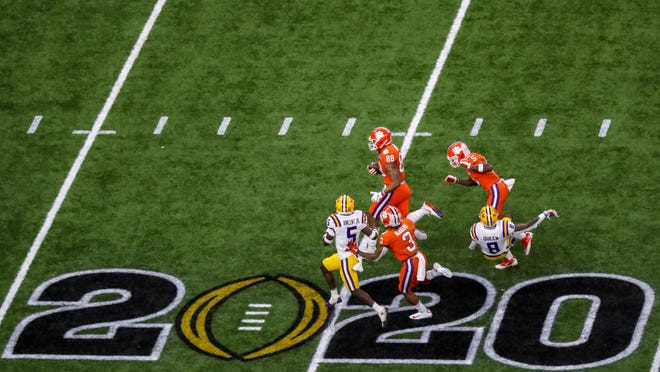 Clemson tight end Braden Galloway, with the ball, runs downfield after a catch in last season's CFP championship game against LSU. This fall, the ACC, Big 12 and SEC will play football. The Big Ten, and maybe the Pac-12, might play their seasons next spring.