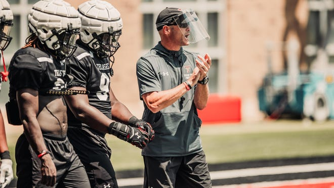 Texas Tech has closed its Football Training Facility after a new outbreak of COVID-19 cases within the program. Tech coach Matt Wells, center, missed the Red Raiders' season finale Saturday against Kansas, and Tech said eight other coaches, one player and additional personnel have tested positive within the past seven days.