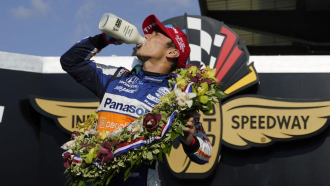 Takuma Sato of Japan celebrates after winning the Indianapolis 500 at Indianapolis Motor Speedway on Sunday in Indianapolis.
