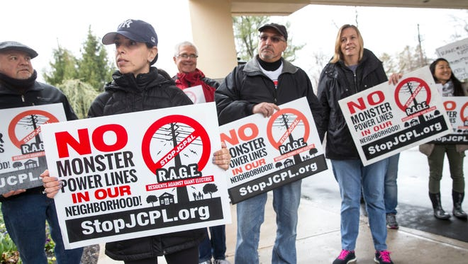 Residents of Middletown, Hazlet, and Red Bank stand outside and protest the plan to place power lines near residential properties. Representatives of FirstEnergy JCP&L hold a press conference to give an update on the Monmouth County Reliability Project.    