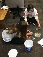 "Mount Vernon eighth grade students count money for the ""It takes change to make change"" fundraiser to benefit Rockport-Fulton High School. The Texas high school was severely damaged by Hurricane Harvey."