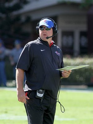 Louisiana Tech coach Skip Holtz watches a video replay during the first half Saturday's game at Mississippi State/