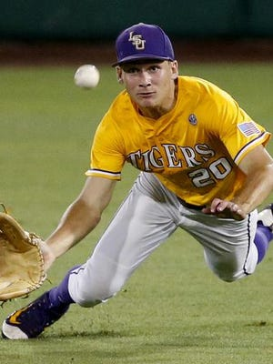 LSU outfielder Antoine Duplantis (20) dives in vain for a ball that was hit for an RBI single off the bat of Rice's Ryan Chandler in the seventh inning of Monday's Baton Rouge Regional game.