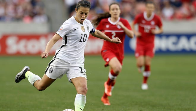 Carli Lloyd (10) dribbles against Canada in the second half during the 2016 CONCACAF women's Olympic soccer tournament at BBVA Compass Stadium on Feb. 21.