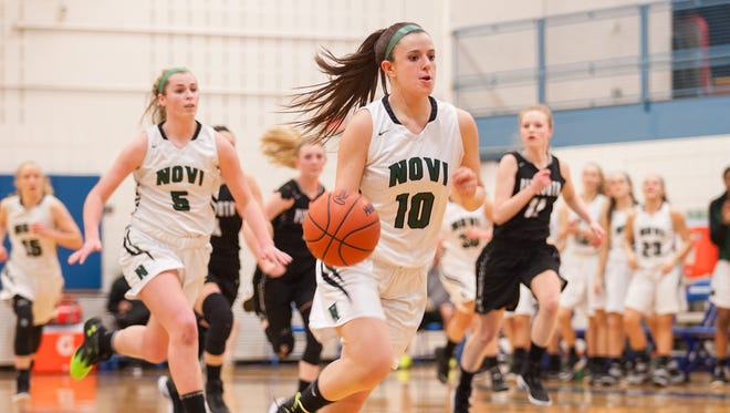 Novi's Cara Ninkovich drives to the basket during a girls basketball district playoff game against Plymouth on Monday, Feb. 27, 2017 at Salem High School in Plymouth, Michigan. Novi won 51-29.