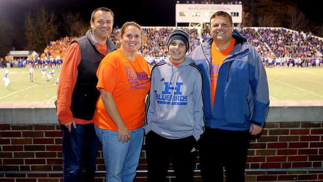Brady Walz (second from right) joins (from left) his uncle, Jeff Walz, aunt Jaime Walz-Richey and dad Brian Walz at the Elder vs. Highlands football game in October of 2014.