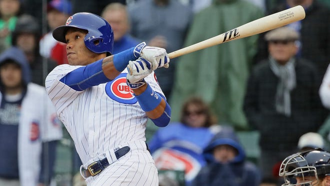Addison Russell hits a three-run walk-off home run in the bottom of the 9th inning against the Brewers at Wrigley Field.