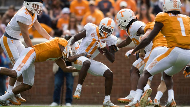 Tennessee wide receiver Jordan Murphy is taken down during the Tennessee Orange & White spring game at Neyland Stadium at University of Tennessee Saturday, April 21, 2018.