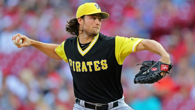 Pirates starting pitcher Gerrit Cole throws against the Reds during the first inning at Great American Ball Park in Cincinnati.