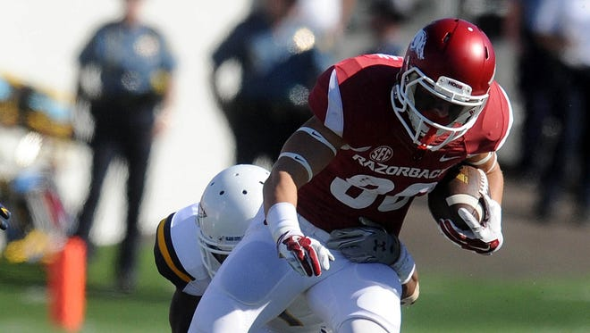 Arkansas wide receiver Drew Morgan (80) and his teammates became the first top 25 team to be upset this season.