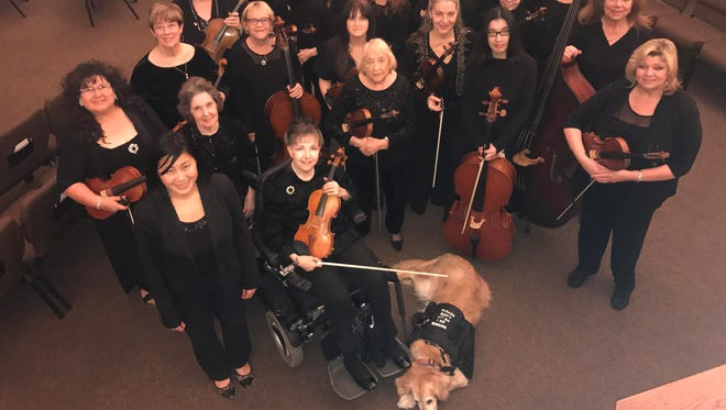 The brand-new Women's Orchestra of Arizona is lead by conductor Livia Gho (lower left).