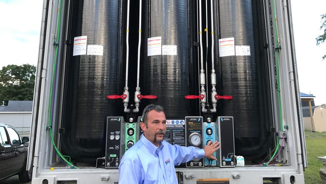 Kevin Whitehead, director of transportation and logistics for NG Advantage, explains how a trailer is equipped to transport compressed natural gas from the filling station to clients.