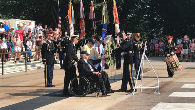 Lauren Bruner, Ken Potts and Donald Stratton, survivors of the 1941 Japanese bombing of the USS Arizona at Pearl Harbor, lay a wreath at the Tomb of the Unkowns at Arlington National Cemetery, July 21, 2017.