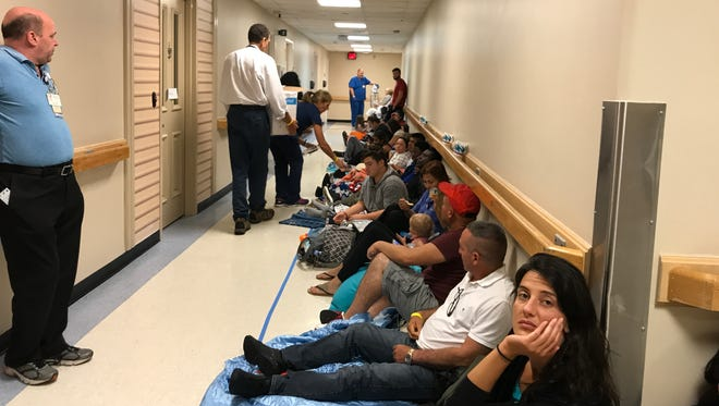 Hurricane Irma evacuees shelter in a hallway Sunday, Sept 10, 2017, at NCH Healthcare System's Downtown Baker Hospital.