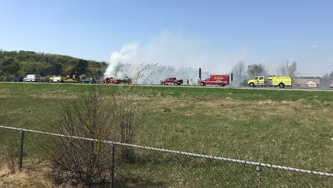 Firefighters and other emergency crews respond to a grass fire near State 29 in Wausau on Wednesday, May 16, 2018.