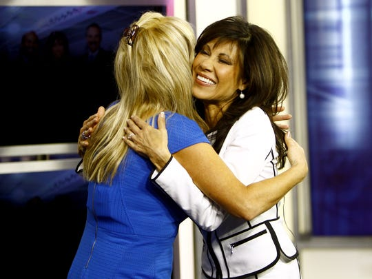 Fay Fredricks, left,  gives Lin Sue Cooney a hug during Cooney's final broadcast at the 12 News studio in Phoenix, Az. on Friday, May 29, 2015.