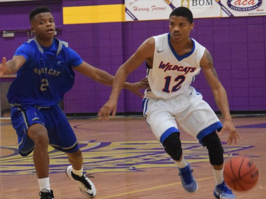 Louisiana College's Timothy Stokes (12, right) looks to get past Rust College defender Omar Wright (2, left).