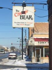 The Chicago Bear Sports Bar & Grill is near Midway