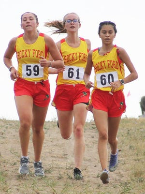 Rocky Ford High School;s Abbi Snyder (left), Kaysa Kurtz (center) and Katie Preciado (right) set the pace at the Peyton Invitational last Friday. Preciado finished third, Kurtz fourth and Snyder fifth as the Lady Meloneers won the meet.
