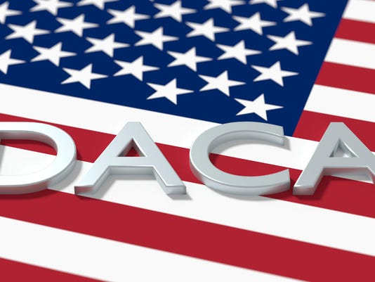 The word daca on an american flag immigration concept
