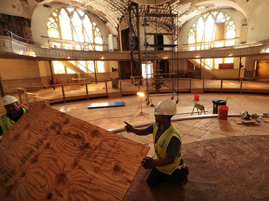 Louis Rayes (right) and Jose Baragas repair the dias during renovations of Clayborn Temple in downtown Memphis. The nonprofit Neighborhood Preservation Inc. has begun what could be a multimillion-dollar project to rehab the church, which was at the center of the sanitation worker strikes of 1968, by April of 2018, the 50th anniversary of Dr. Martin Luther King Jr.'s assassination.