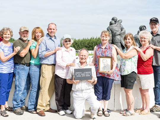 """Family and friends of the late Lawrence """"Popeye"""" Schreiner Sr. gathered for a Korean War Tribute Stone placement ceremony June 11 at The Highgrounds Veteran's Memorial Park near Neillsville. Pictured, from left, are John Gerold, Geri Gerold, Jeff Bauer, Lisa Bauer, Jed Bauer, Mary Ann Bauer, Jim Bauer, Linda Bauer, Dawn Fuehrer, Betty Odegard and Jon Marion."""