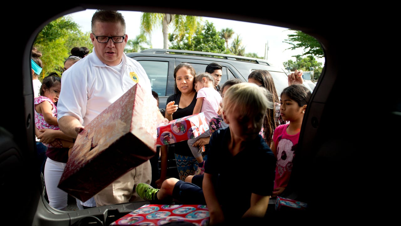 Stuart Police officers passed out hundreds of donated gifts and turkeys to residents of East Stuart on Dec. 21, 2016, ahead of the Christmas holiday.