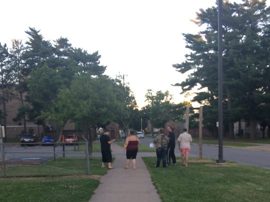 Tyler Kannenberg hunts for Pokemon with a group to ensure safety.