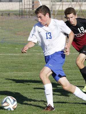 Horseheads' Nick Juan controls the ball in front of Elmira's Pat Milliken during boys soccer Wednesday at Horseheads High School.