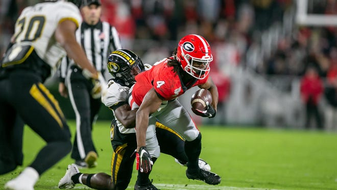 Georgia running back James Cook (4) runs the ball in the first half of a NCAA football game between Georgia and Missouri in Athens, Ga., on Saturday, Nov. 9, 2019.